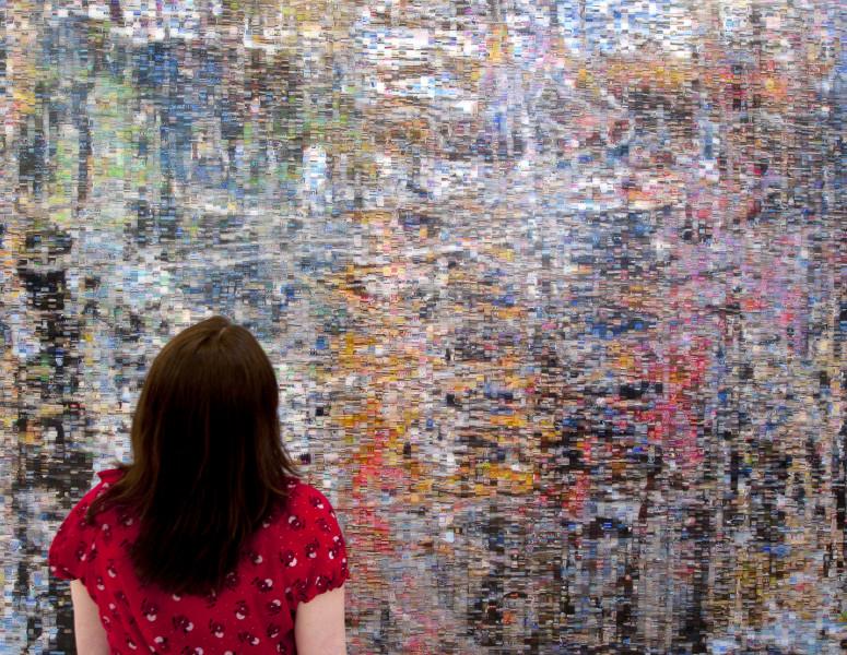 Image of Woman looking at abstract art
