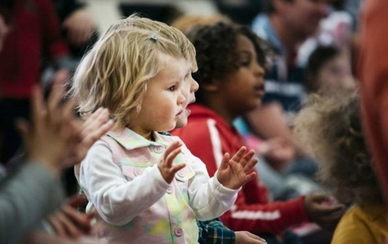 Image of Audience of children clapping