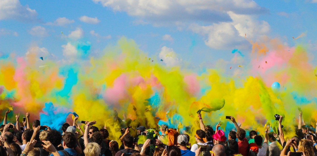 Image of Crowd with coloured power paint clouds