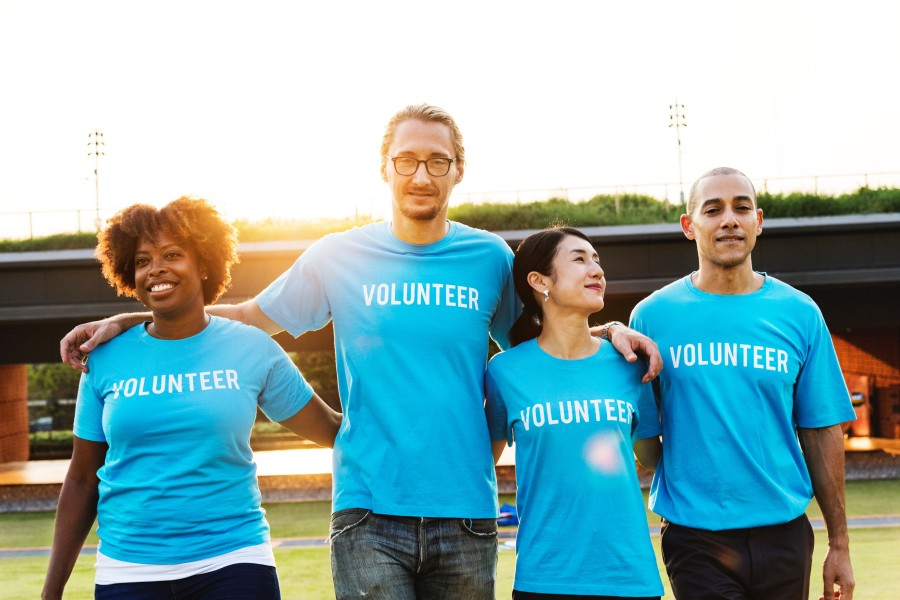 Image of Volunteers in blue tshirts