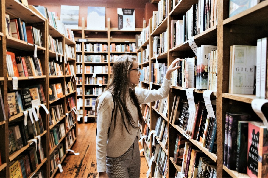 Image of Young woman in library