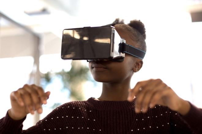 Image of girl wearing virtual reality headshot