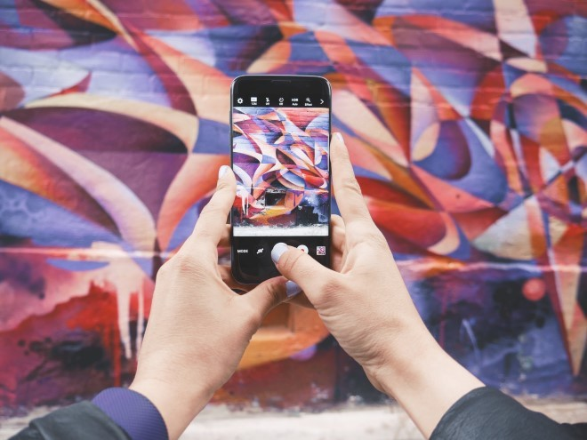 Image of iphone photographing graffiti